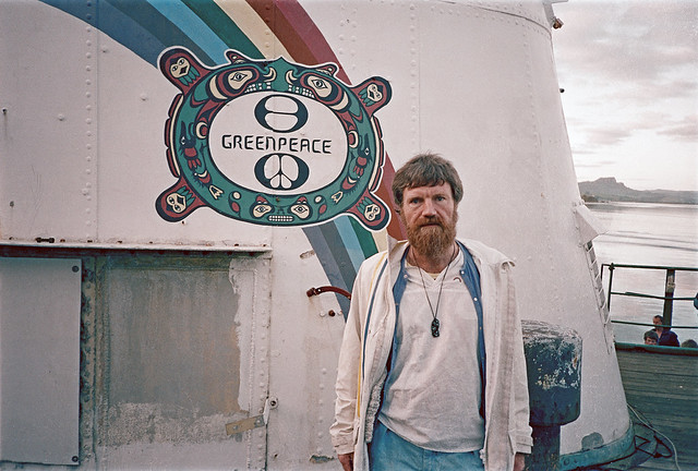 David Robie in 1985 pictured beside the distinctive Krakiutl Indian totem on the Rainbow Warrior's funnel. Image: John Miller
