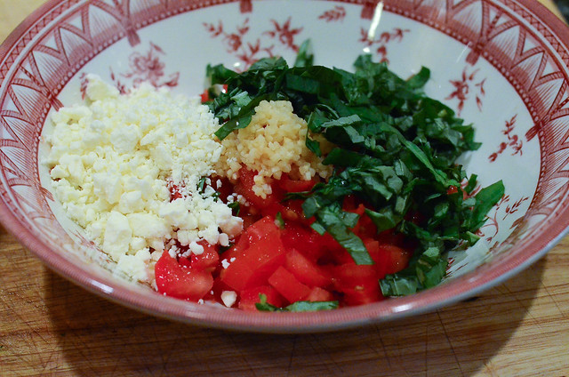 The rest of the Feta Bruschetta ingredients all piled up in one bowl.