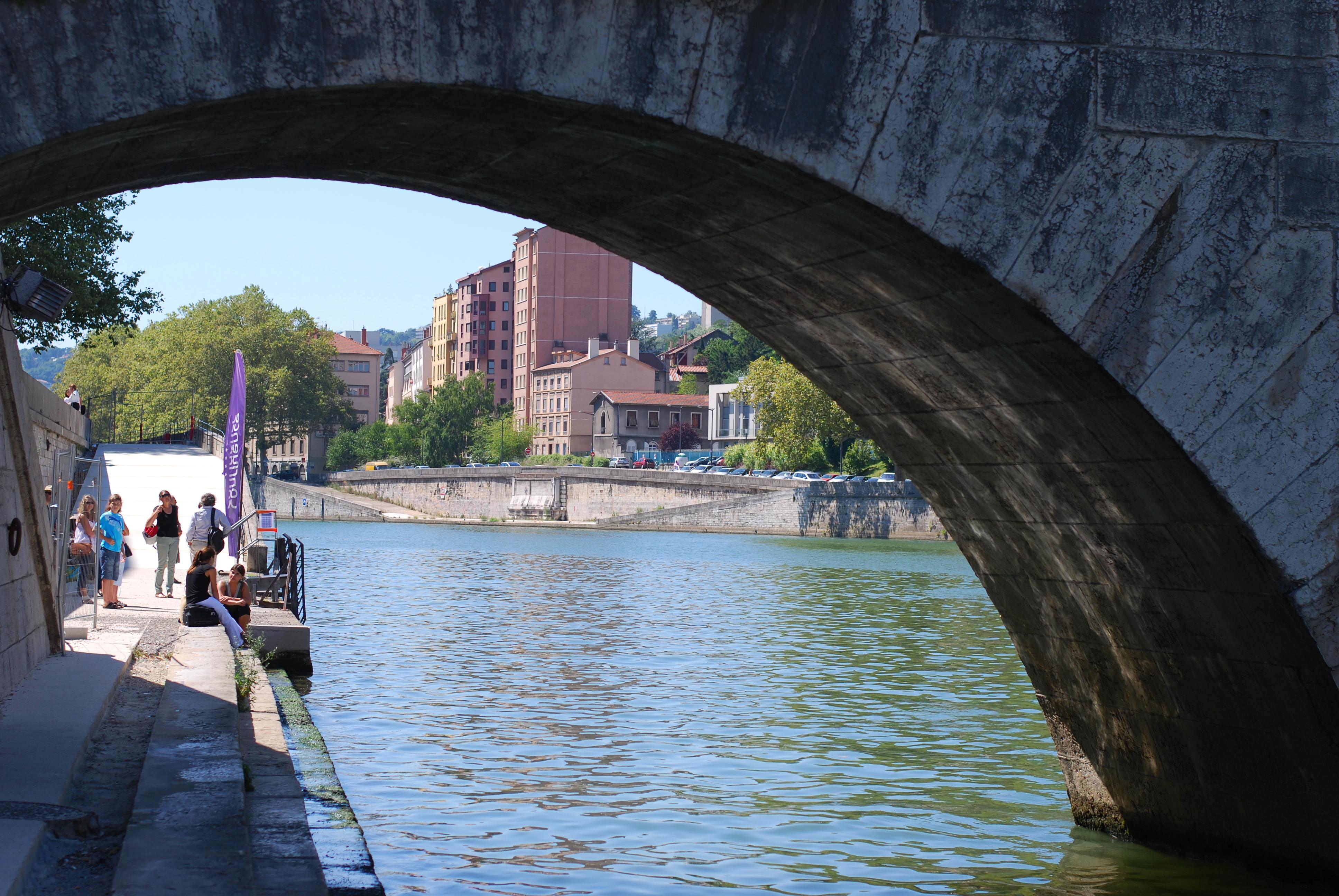 chambray and curls Lyon Riverside under the bridge France Summer Travel