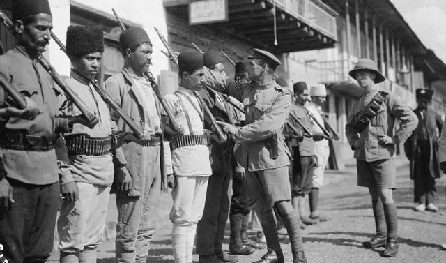 A British officer from the Dunsterforce watches a Russian instructing a group of Persian police at Resht.