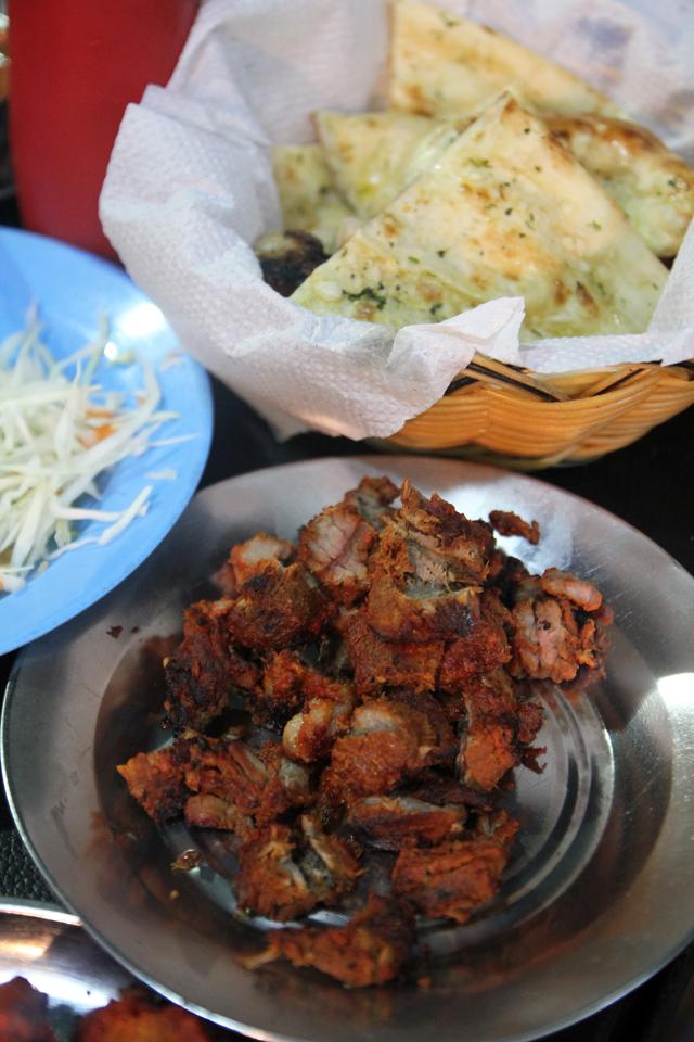 Dinner is served at Ali's restaurant, Dar Es Salaam, Tanzania