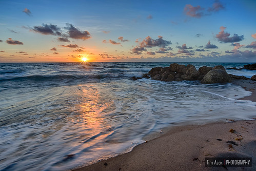 ocean sunset sea vacation sky orange usa sun sunlight reflection beach water yellow rock skyline clouds america sunrise landscape coast sand rocks waves ray florida cloudy tide shoreline rocky boulders shore deerfieldbeach hdr saltwater hightide stareffect timazar