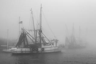 Shrimp boat in fog