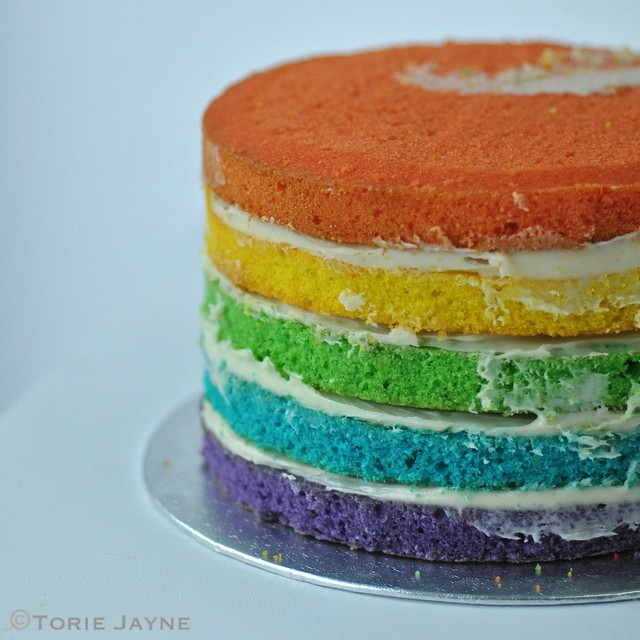 Stacking the rainbow cake 3