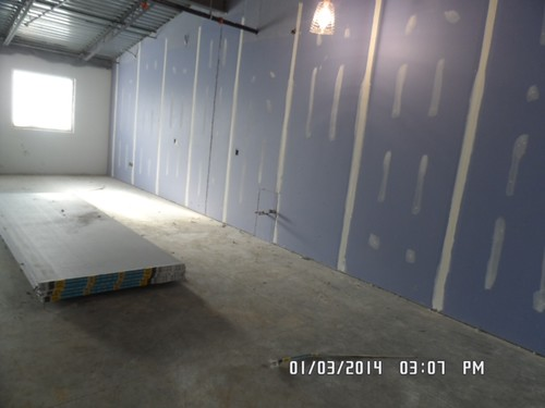 Finishing drywall in classroom