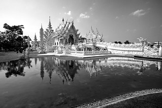 Image of Wat Rong Khun - White Temple. architecturalarchitectureasiaasianbodybuddhabuddhismbuddhistbuildingcalmchiangculturedecorationdetailhistorichistoricalholidayimagekhunlandmarkmemorialmodernnorthernorientalornamentpeaceraireligionre