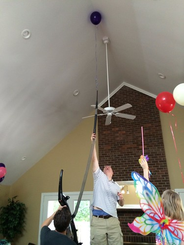 Balloon escaped into the vaulted ceiling. Engineer/scientist brains figured out barstool + vacuum extension hose to get it down.