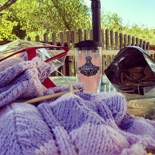 View from my little corner of the world right now... #bruins #crystallight #knitting #yarn #knitstagram #PopCorners #deck #spring