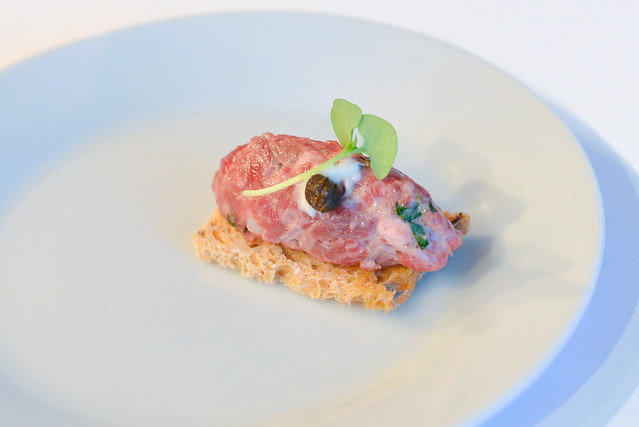 Nick + Stef's Steakhouse dry aged steak tartare, olive crostini