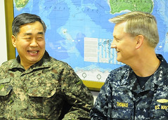 Vice Adm. Jung Ho-sub, Republic of Korea Navy fleet commander, speaks with Vice Adm. Robert L. Thomas Jr., U.S. 7th Fleet commander aboard USS Blue Ridge (LCC 19). (U.S. Navy/MC1 Joshua Karsten)