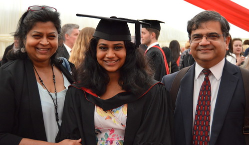 Nila Murali with her parents