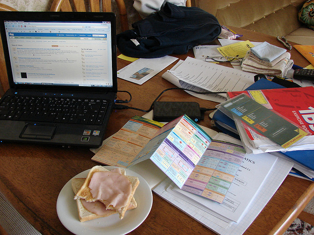 Cluttered desk with sandwich
