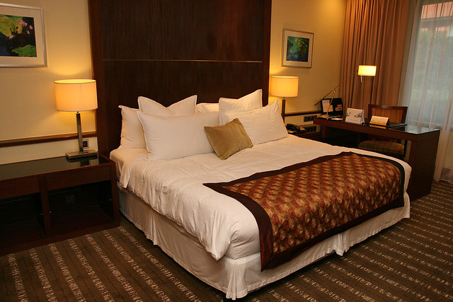 A beautiful king size bed in the master bedroom of the Premier Suite