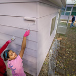 13-043 -- As part of Alternative Fall Break, Jennifer Carter '17 and Lisa Mishra '15 helped paint the house and garage of Elaine McGuffin as a community service project.