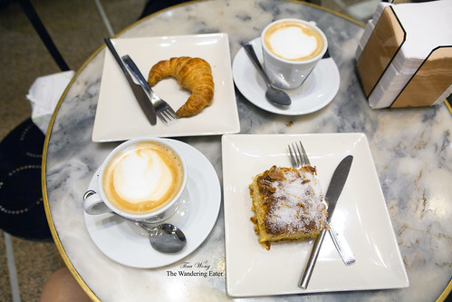 Cappuccino, croissant, orange and almond cake