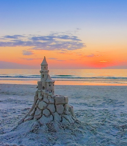 Medieval Sandcastle on the Beach at Sunset