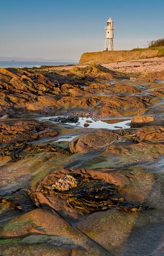 sunset lighthouse seaweed rocks shadows portishead somerset severn lowtide goldenhour trinityhouse blacknore