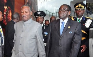 Zimbabwe President Robert Mugabe with Michael Sata of Zambia at the African Union Summit in Addis Ababa, Ethiopia on January 30, 2014. Mugabe was elected as deputy chair. by Pan-African News Wire File Photos