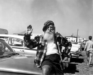 An old man sits on the car during the Grand Prix race in Sebring