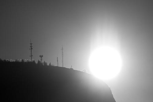 sunrise dawn sky mountains radio broadcast towers transmitters silhouettes shining shine rays bw mono black white grey gray nature landscape kelowna bc canada okanagan