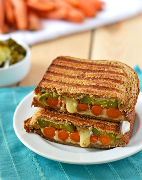 Roasted Carrot Grilled Cheese with Havarti and cayenne Dijon spread on a white plate
