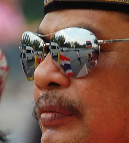 A Thai man wearing reflective sunglasses