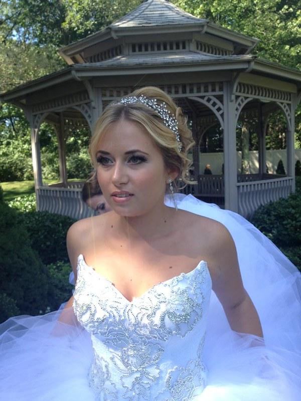 Marina wearing a crystal spray vine and crystal drop earrings by Bridal Styles Boutique