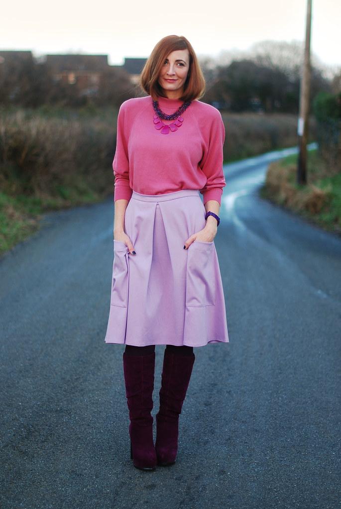 Pink sweater, lilac midi skirt & magenta boots