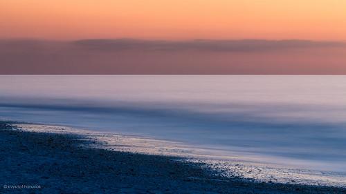 ocean longexposure sunset sea orange water twilight rocks waves glow unitedstates florida horizon smooth nd fl minimalism marcoisland hanusiak