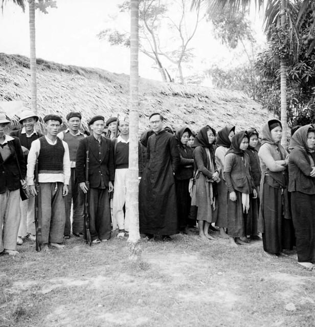 North Vietnam 1950 - Father Joseph Yen and villagers in Vinh Yen