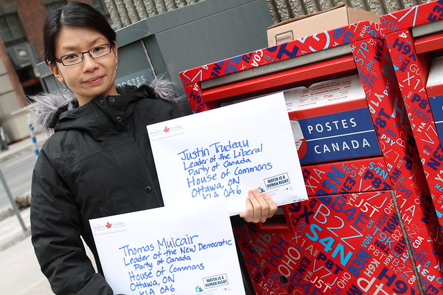 Emma Lui posting World Water Day letters to Trudeau and Mulcair