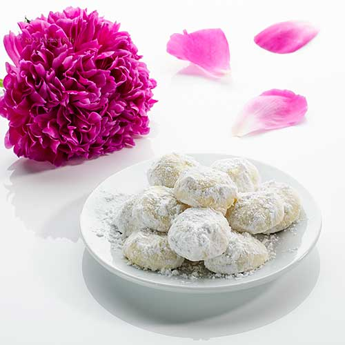 Wedding Cookies on plate with flower in background