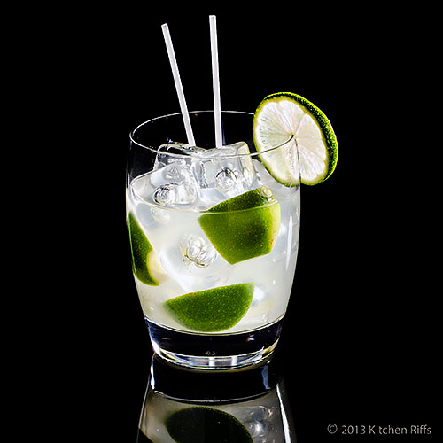 Caipirinha Cocktail in rock glass with lime garnish