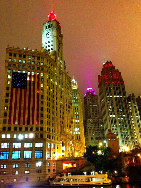 Giant American flag on Wrigley Building in Chicago fog