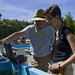 ODU Professor Richard Zimmerman talks to Summer Communications Intern Erika Lower about how his lab's seagrass experiments. ©Stephanie Chavez/VASG