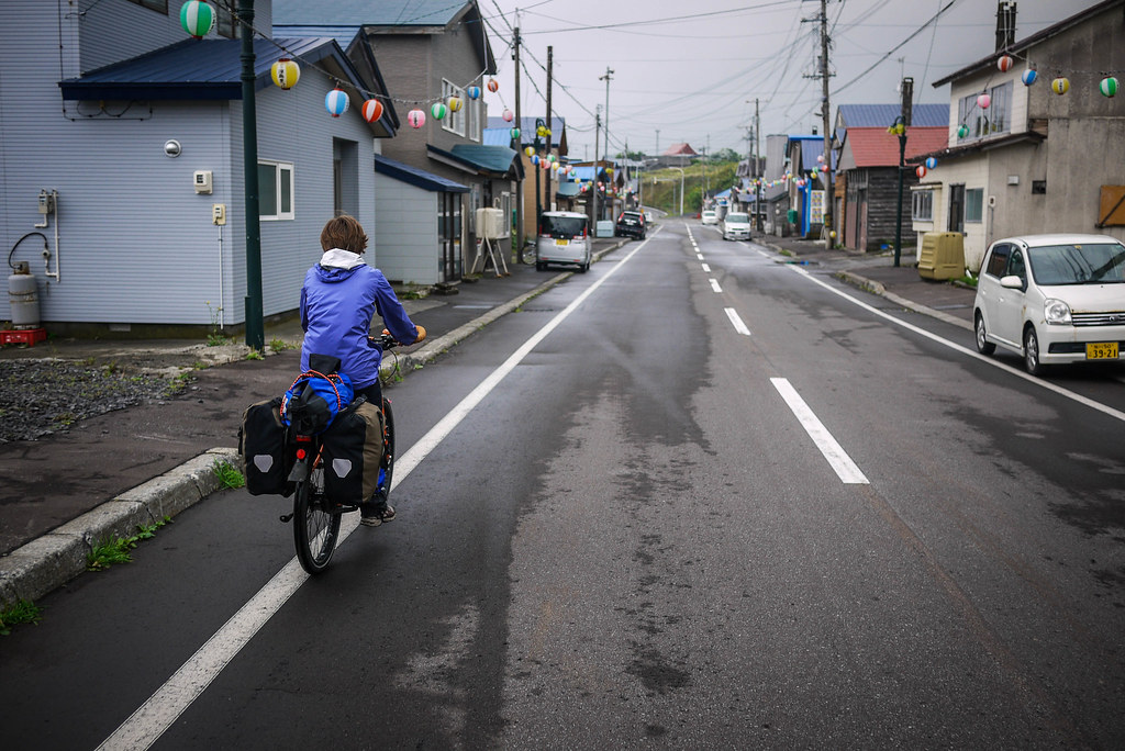 Cycling through one of many quaint fishing villages on RIshiri Island, Japan