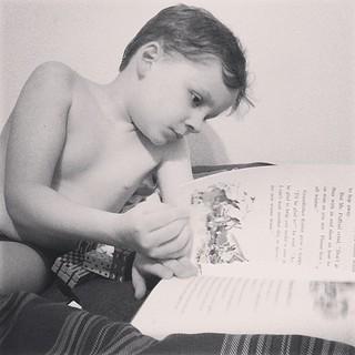 Reading before he sleeps.