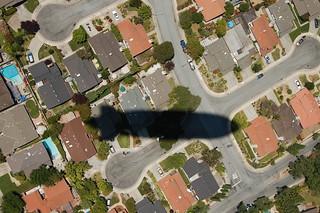 Zeppelin shadow over suburbia