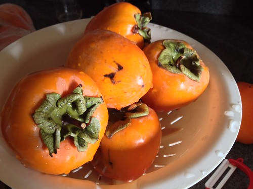Persimmons, washed