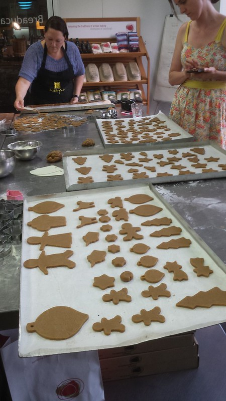 Cut gingerbread dough on baking trays