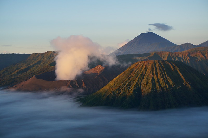 Iconic view of Indonesian volcanoes on Java at sunrise