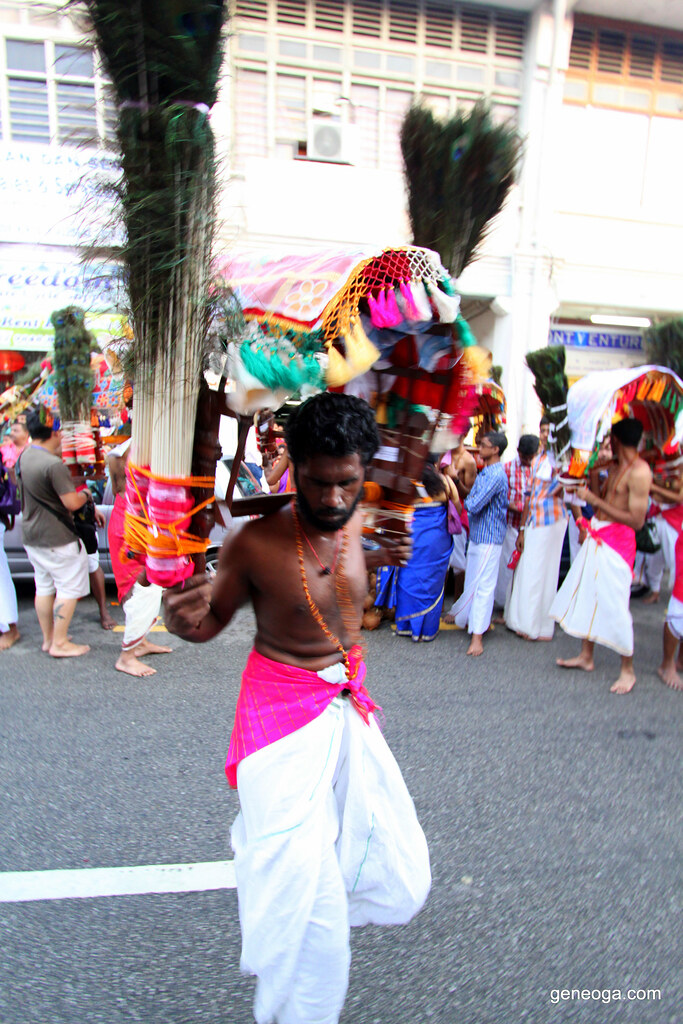 Devotee carrying the Kavadi doing the Kavadi Attam