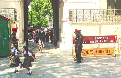 Kids charge through the City Palace gates