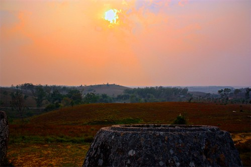the clouds painted the sun as it set over the plain of jars