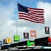 The American flag flies over Pocono Raceway and the Andretti Autosport transporters