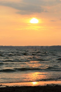 Sunset and waves at Outlet beach