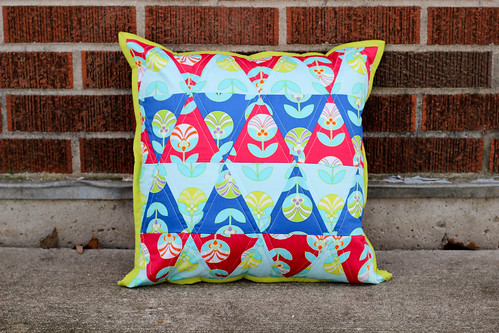 Color Me Retro Triangle Pillow by Jeni Baker