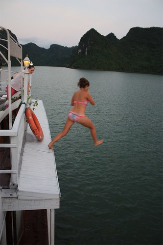 Lina jumping off of our boat