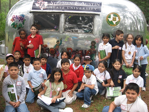 More than 1,500 inner-city youth from Houston Independent School District gather over a week-long period at Jones State Forest – Children's Forest each year to participate in the annual Exploring Houston's Backyard. The Bosque Móvil-Forest Mobile is one tool the U.S. Forest Service's Latino Legacy program uses to provide learning experience around Texas.