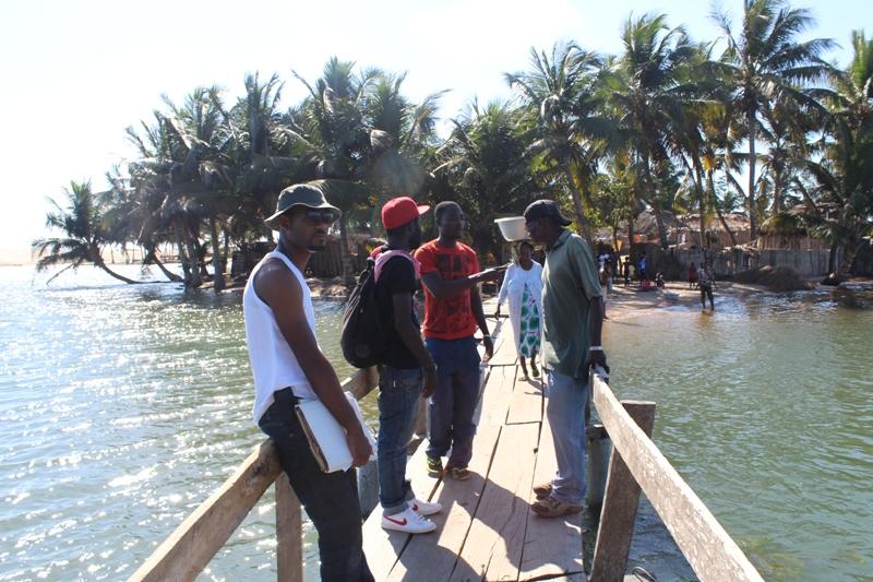 crew on wooden bridge